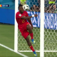 Michy Batshuayi celebrated Belgium's opening goal by kicking the ball into his own face