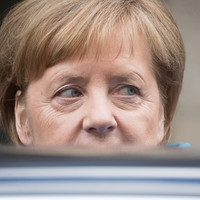 Merkel fighting for her political life as allies mull over migrants deal