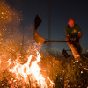 Firefighters in England tackle 'aggressive' moorland wildfire after two blazes merge