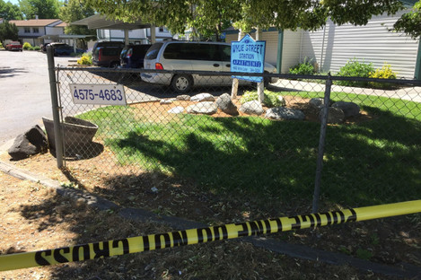Police tape blocks off an area at the apartment complex where the attack happened