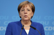 Merkel and minister reach late-night deal to avert government split