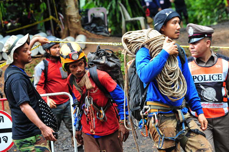 Rescuers with supplies outside the cave