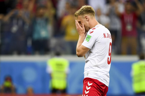 The striker is pictured distraught after his penalty miss against Croatia.