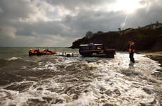 Six rescued after four men swam to save two girls drifting out to sea on airbed