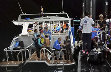 At least 10 dead and dozens missing as tourist boat sinks in Thailand