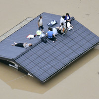 At least 20 dead as record Japan rains prompt mass evacuations