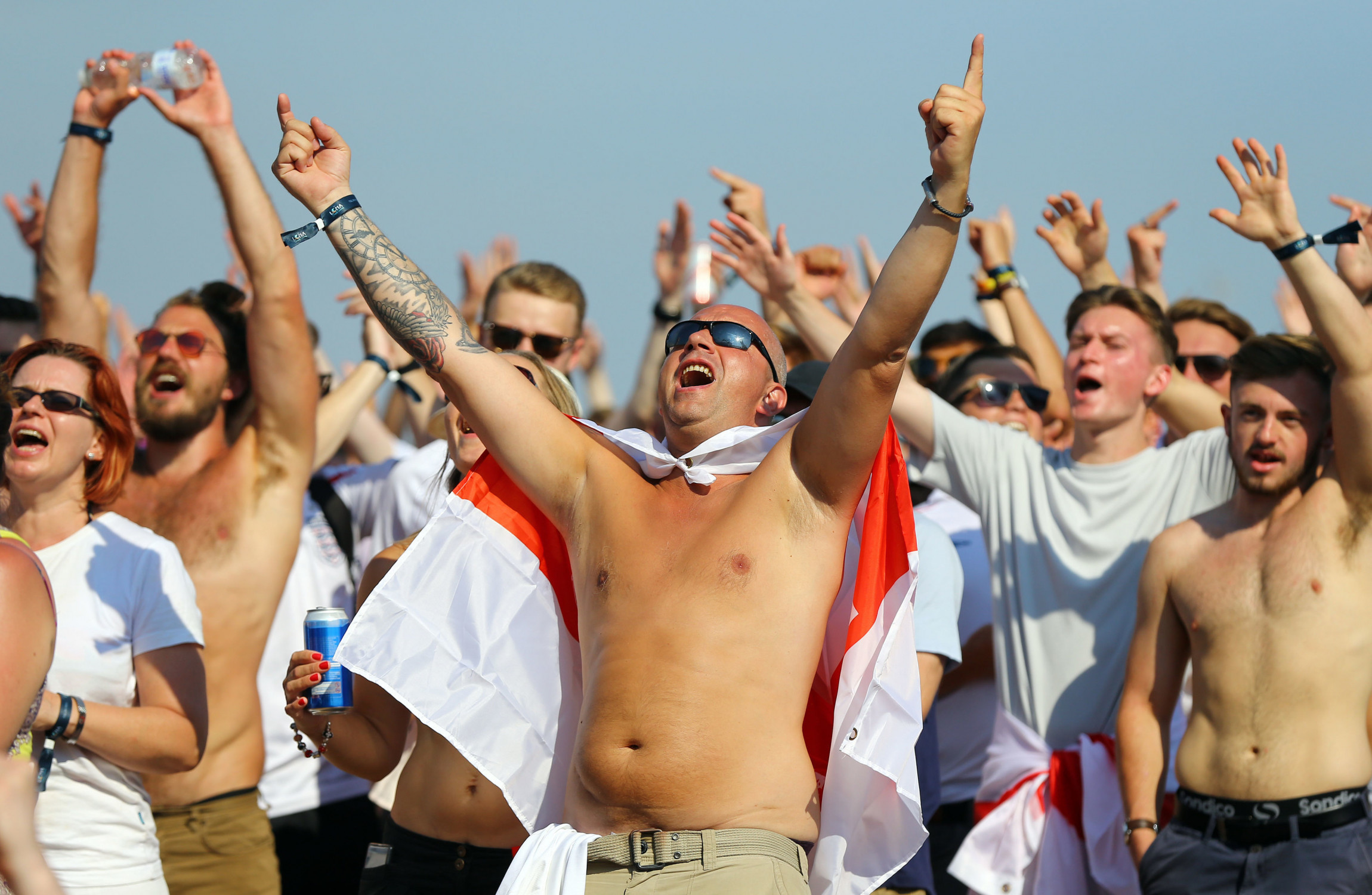 England supporters send gallons of beer into the air celebrating goal forecasting