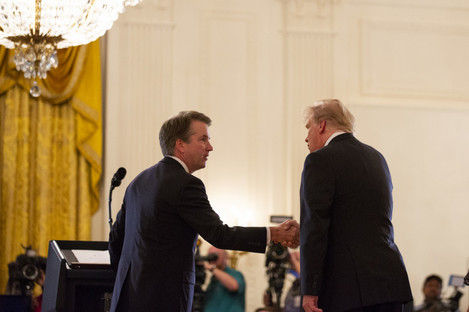 President Donald Trump shakes hands with Brett Kavanaugh, his Supreme Court nominee.