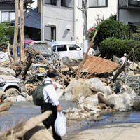Japan rescuers carry out house-to-house searches as floods and landslides claim 141 lives