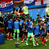 'They suddenly realised I was underneath them' - The photographer who became part of Croatia's goal celebration