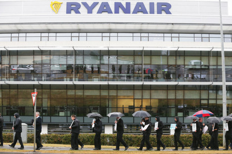 Pilots on strike in the rain outside Ryanair head office in Swords, Dublin