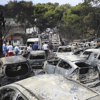 Flames ravage Greek seaside as wildfires kill 74