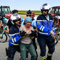 Police use 'tear gas' on Tour de France protesters who blocked route with bales of hay