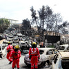 79 dead and 187 injured: Rescuers search Greek towns after deadly wildfires