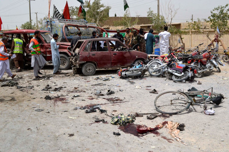 Security officials inspect the blast site in southwest Pakistan's Quetta