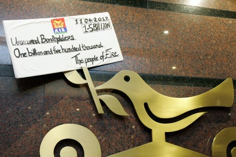 A placard left inside an AIB office in Dublin by protesters earlier today.
