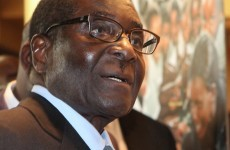 "Mugabe  arrives home - reports of illness ""hogwash"""