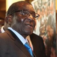 """Mugabe  arrives home - reports of illness """"hogwash"""""""