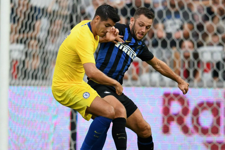 Chelsea striker Alvaro Morata battles with Inter defender Stefan de Vrij.