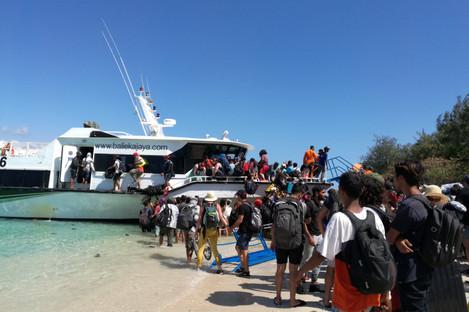 Visitors evacuate from Gili Trawangan near Lombok Island in Central Indonesia