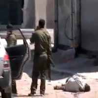 Nine dead as Syrian troops shell Homs ahead of UN resolution vote