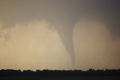 A tornado forms and touches down north of Soloman, Kansas, Saturday, April 14, 2012
