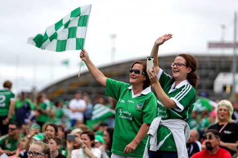 Supporters celebrate Limerick's win at the Gaelic Grounds on Sunday.