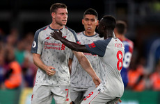 Liverpool maintain positive start with hard-fought win over 10-man Palace