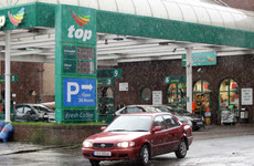 Filling station operator Top Oil has been bought by a Canadian fuel giant