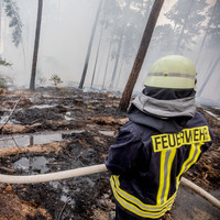 German firefighters stop spread of huge blaze but warn of ongoing threat