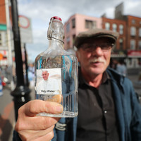 'Pope Francis holy water' selling well at one stall - but flag vendors report quiet day