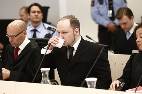 Anders Behring Breivik sits between his defence lawyers during his trial