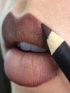 MAC put up an unretouched photo of a model with lip hair, and people are very impressed