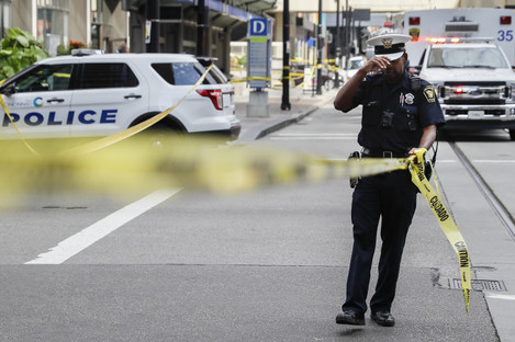 Emergency personnel and police work the scene of shooting near Fountain Square.