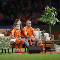 Sneijder sat on a sofa watching career highlights with his family after final Dutch appearance