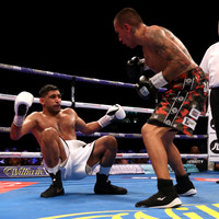 Khan survives heavy knockdown and hairy moments to dominate Vargas on points