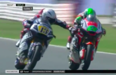 Surreal scenes as MotoGP rider disqualified for grabbing opponent's brake lever