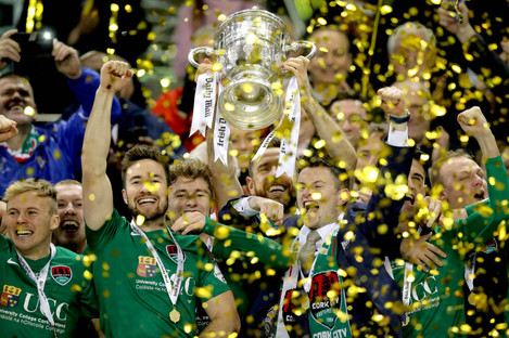 Cork City's Alan Bennett lifts the FAI Cup after defeating Dundalk in last season's final at Lansdowne Road.