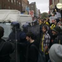 Riot gardaí clash with demonstrators in Dublin