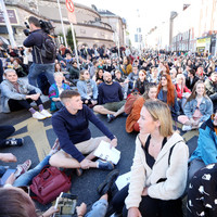 Housing activists block traffic in Dublin during sit-down protest against Frederick Street eviction