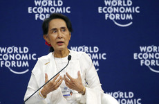 Aung San Suu Kyi defends court decision to jail two Reuters reporters