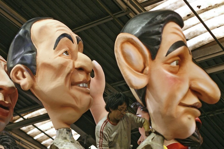 Giant figures depicting Francois Hollande, left, and Nicolas Sarkozy, during preparations for the 128th Nice carnival parade