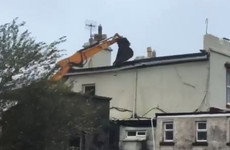 JCB prevents roof blowing off building in Galway