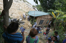 Rescuers frantically dig for survivors as death toll rises after landslide in the Philippines