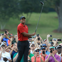 Composed Tiger Woods on course to secure first title since 2013