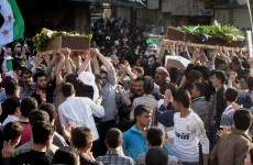 Activists: Syrian troops attack Damascus suburb