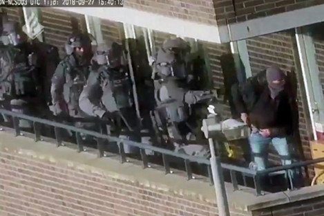 Armed police prepare for an operation in a residential area in Arnhem, Netherlands