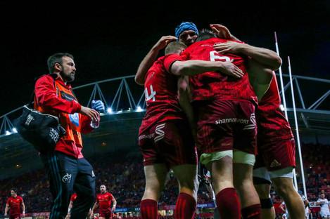 Munster celebrate Peter O'Mahony's try.