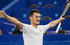 Tomic saves four match points to end three-year title drought
