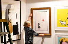 Banksy artwork self-destructs after selling for €1.2 million at London auction